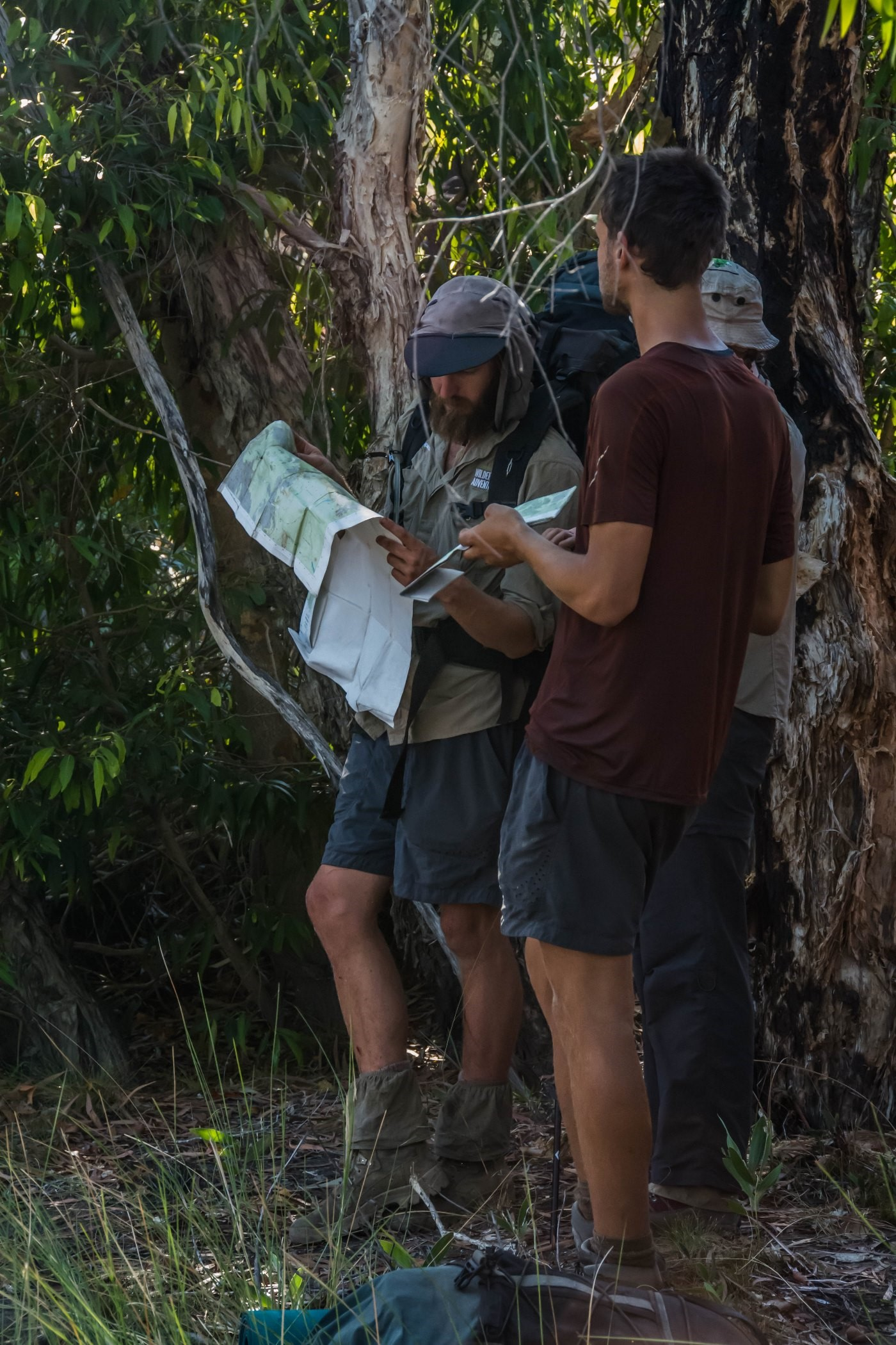 Guide looking at map in Kakadu